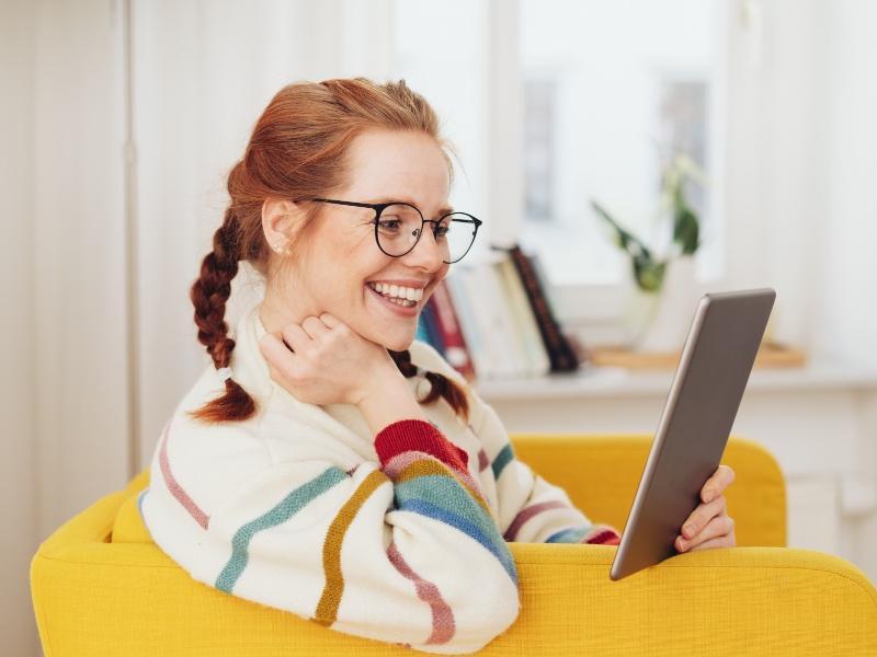 girl reading newsletter on tablet